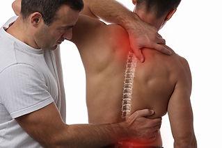 Man having chiropractic back adjustment.