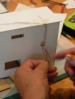 80.burn back the wires to strip down to copper.JPG
