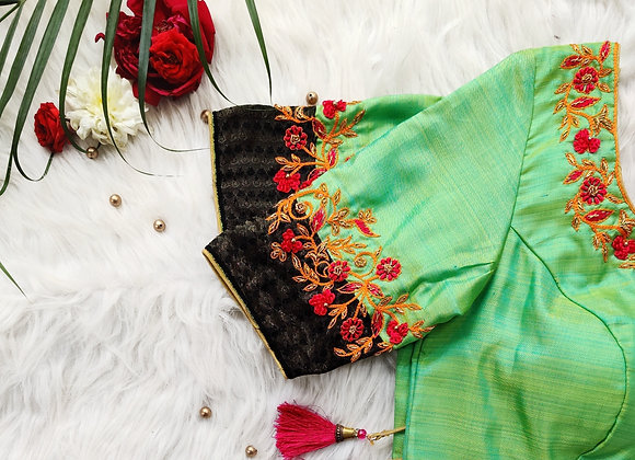 Green and black patchwork blouse