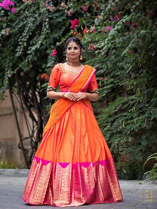 Orange Lehenga with large Kanjeevaram  border