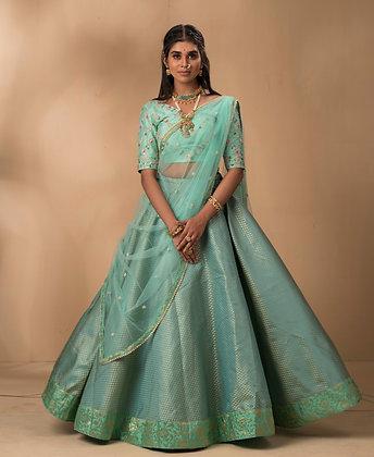 Mint Banaras Lehenga with a raw silk pearlwork blouse