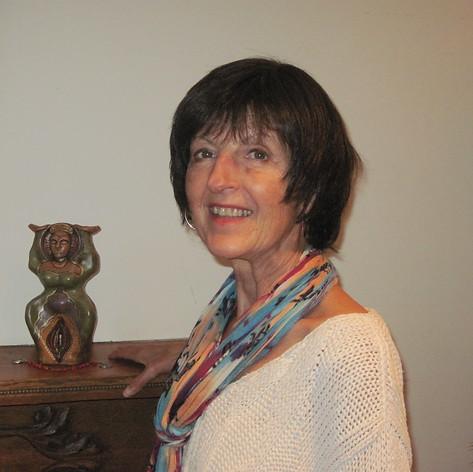 Gina O enjoys a clay sculpture made my Lori