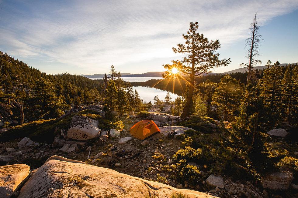 beautiful-shot-of-an-orange-tent-on-rock