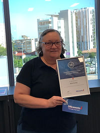 Woman holding Officeworks certificate
