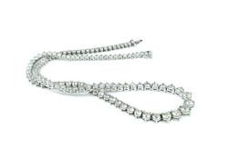 diamond necklace on table