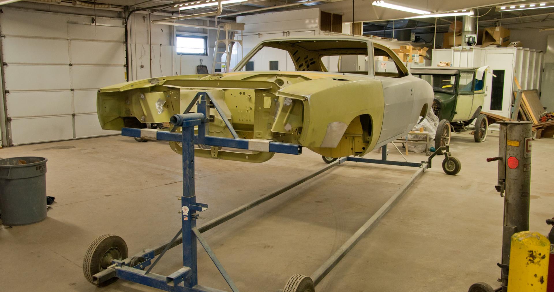 Frame off restoration including a rotisserie.