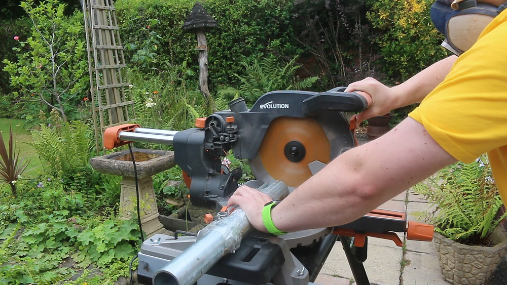 Cutting a piece of tube clamp tube on an Evolution mitre saw
