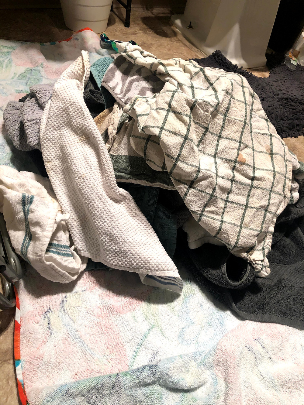 This large pile of reusable towels is ready for a wash!