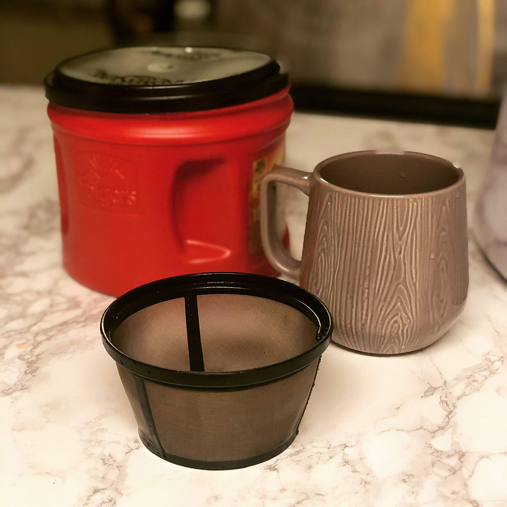 This is my reusable coffee filter, one of my reusable mugs, and the container I take to the store to purchase bulk ground coffee beans.