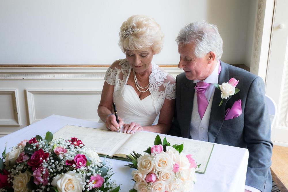 Rosemary & Rick - Signing the Register at Kitley