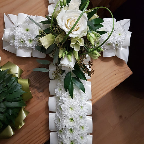 Florist Choice Based Cross with ribbon edging and top-spray
