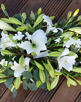 Lily and Orchid Spray funeral tributes