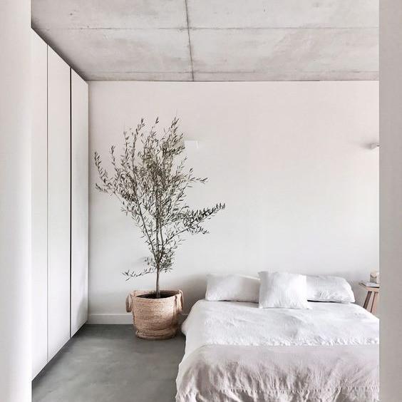 Wicker Basket, concrete ceiling, natural interior, linen bedding, indoor plants