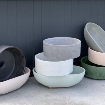 Raw concrete basin, coloured concrete basin