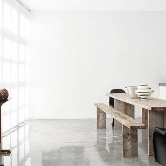Concrete flooring, timber table, handmade pottery, natural interior, nordic interior