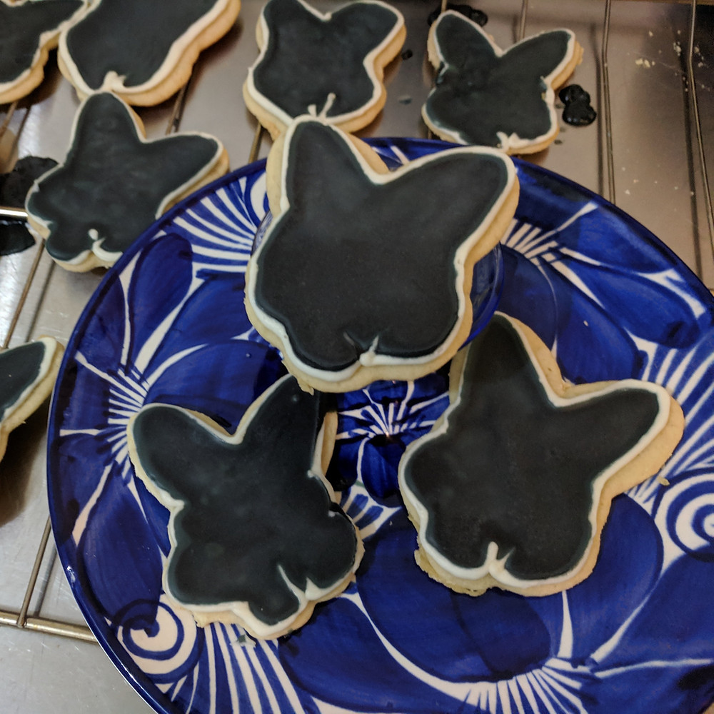 Sugar cookies in the shape of a rabbit's head, with black and white icing to match Tim's, the author's, pet rabbit