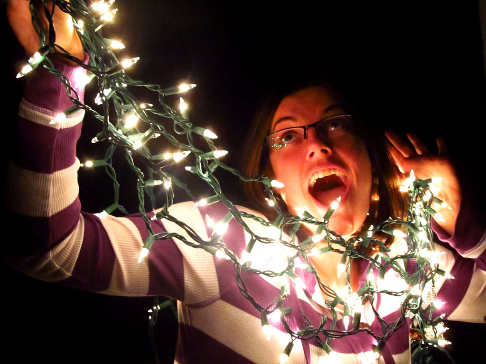 An unrelated photo of a staged Christmas party death by strangulation. The culprit: white string lights. The victim: someone who seems to be smiling too much to really be dying. The conclusion: it's staged.