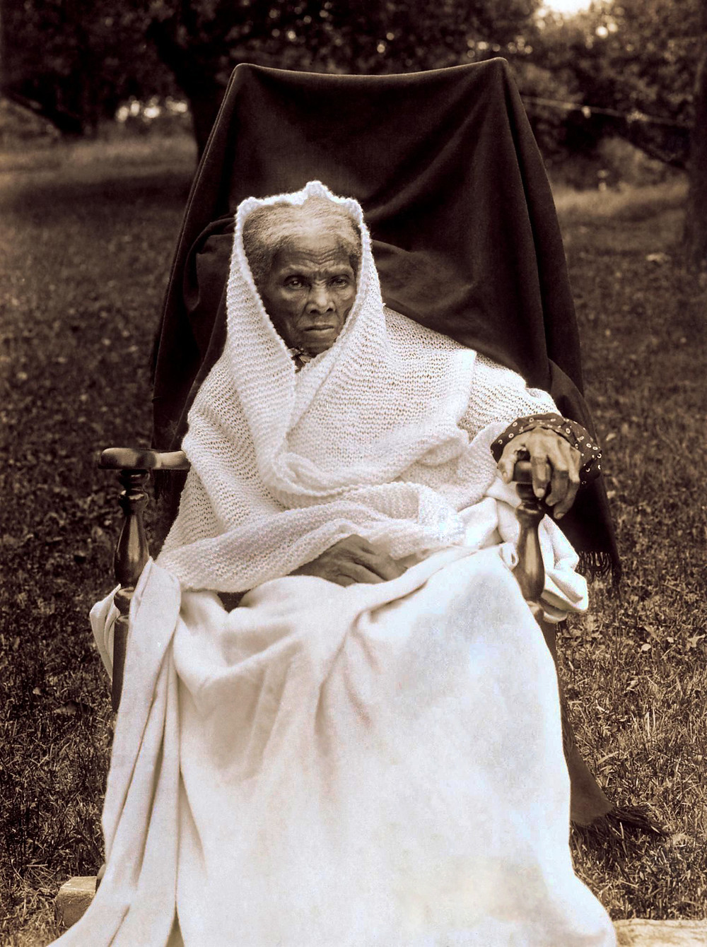 Badass Harriet Tubman, telling you every story with one stare from her awninged wheelchair wrapped in a knit shawl that a lamb shed for her, custom made.