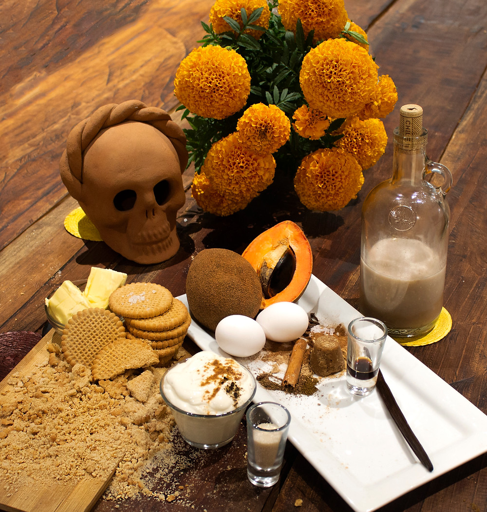 Still life of the pie ingredients, marigolds, and a clay skull