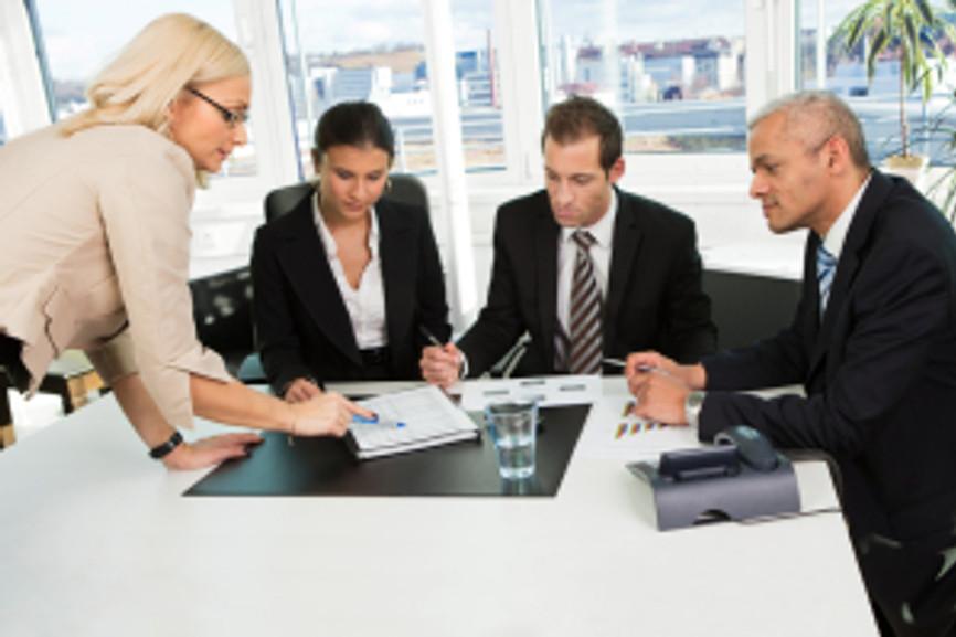 Boss insctructing business team