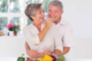 Old-man-tasting-vegetable-held-by-wife-8
