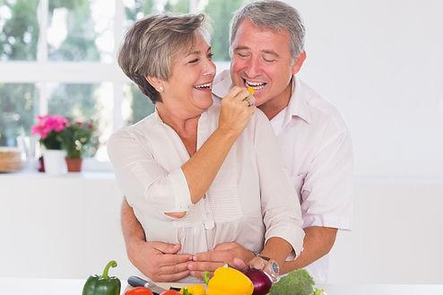 Old-man-tasting-vegetable-held-by-wife-8