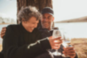 Relaxed-mature-couple-having-a-glass-of-