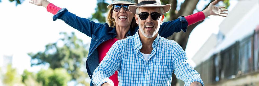 Couple-enjoying-while-riding-bicycle-653