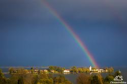 Regenbogen über der Fraueninsel