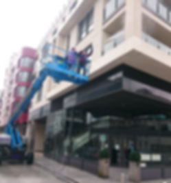 Our Trained Staff Soft Washing a High-Rise Building. Soft Cleaning Building Exteriors.