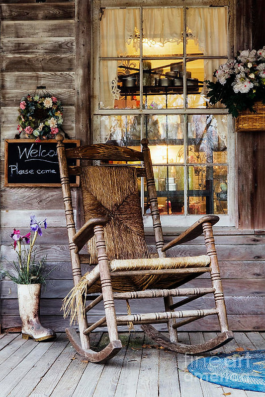 old-wooden-rocking-chair-on-a-wooden-por