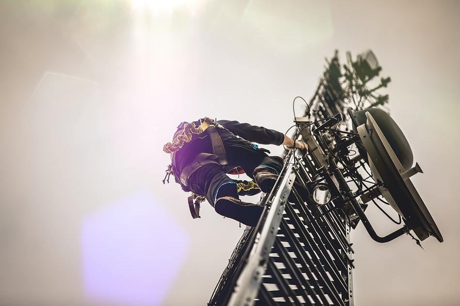 telecom-worker-climbing-antenna-tower-with-harness-2021-04-02-19-11-53-utc.jpg
