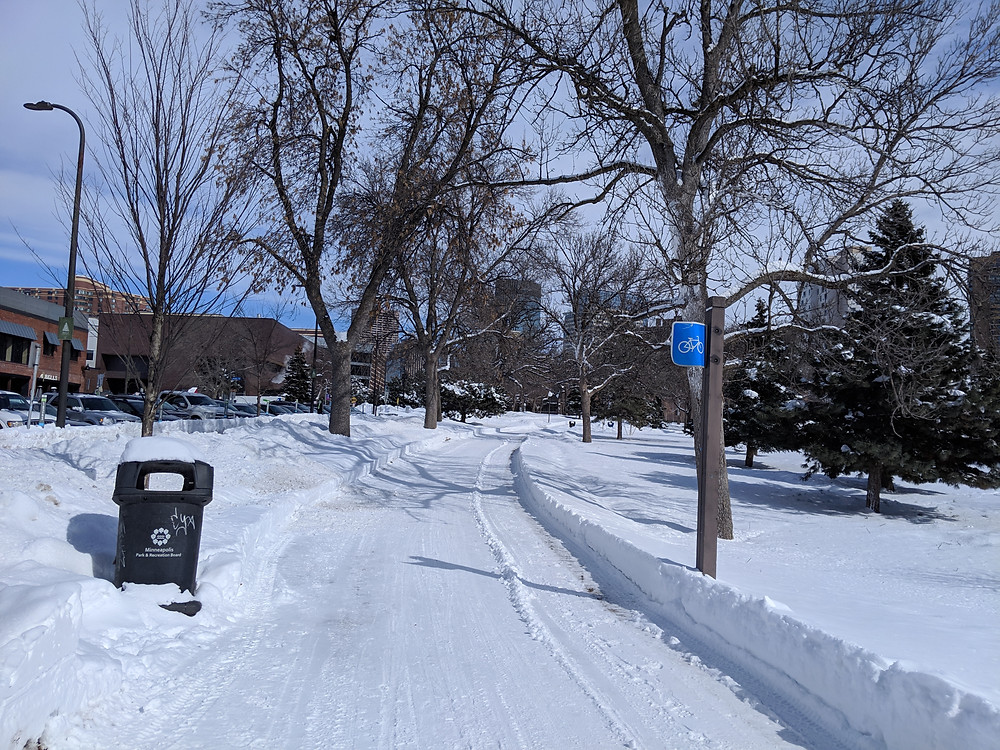 Snow-covered path through Loring Park