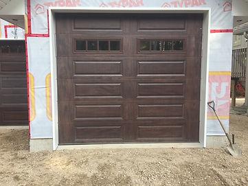New CHI Walnut garage door serviced and installed in Orangeville