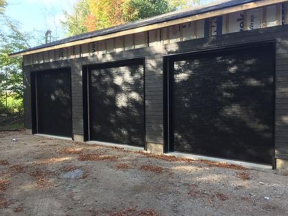 3 Black flush clopay garage doors installed in Orangeville