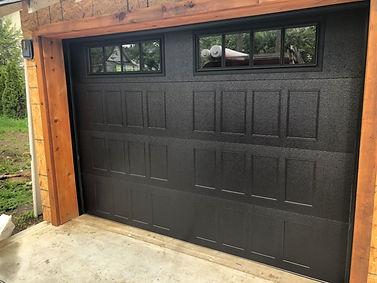 Black recessed panel garage door installed in Orangeville