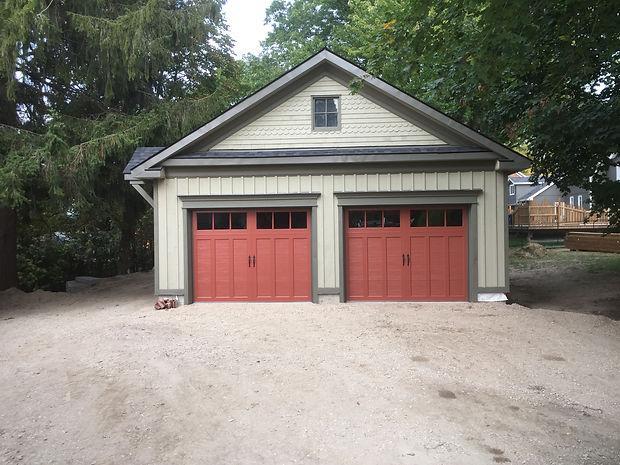 Two Custom Coach garage door installed i