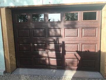 CHI Woodgrain garage door repaired in orangeville