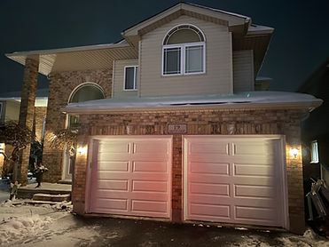 Classic white Clopay Garage door installation in Guelph