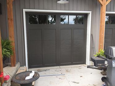 Dark Over lay garage door installed in Guelph Ontario