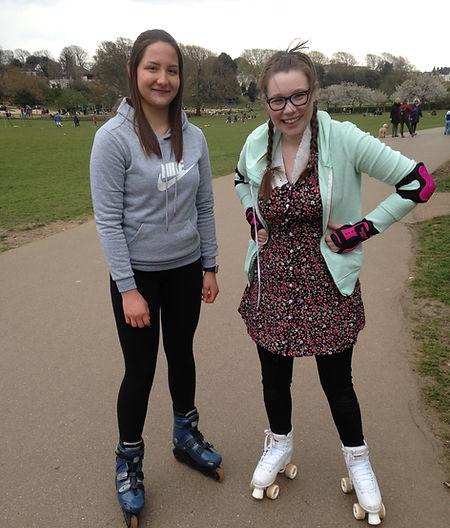 2 girls wearing roller skates