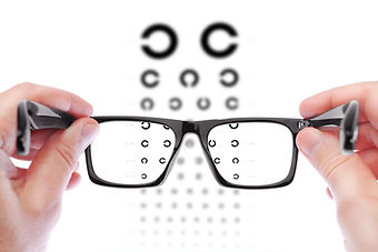 man-checking-vision-with-new-glasses.jpg
