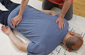 Client receiving shiatsu back stretch (1