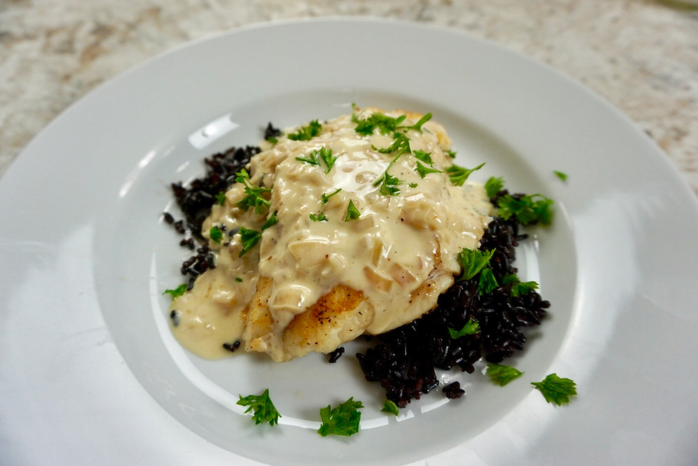 Red Snapper with Beurre Blanc Sauce served over Black Forbidden Rice