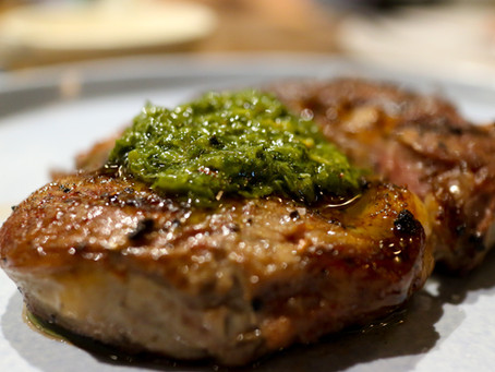 Chimichurri Pork Shoulder with caramelized shallots and peppers