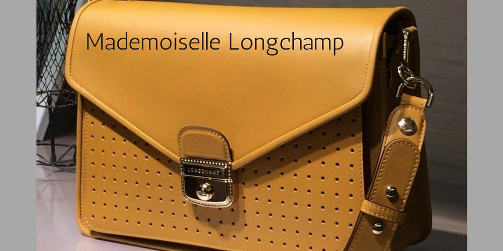 che-sia-benedetta-la-moda-mademoiselle-longchamp-borsa