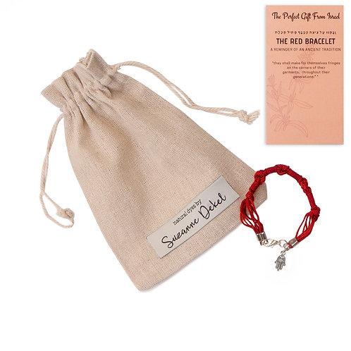 Red bracelet with hamsa
