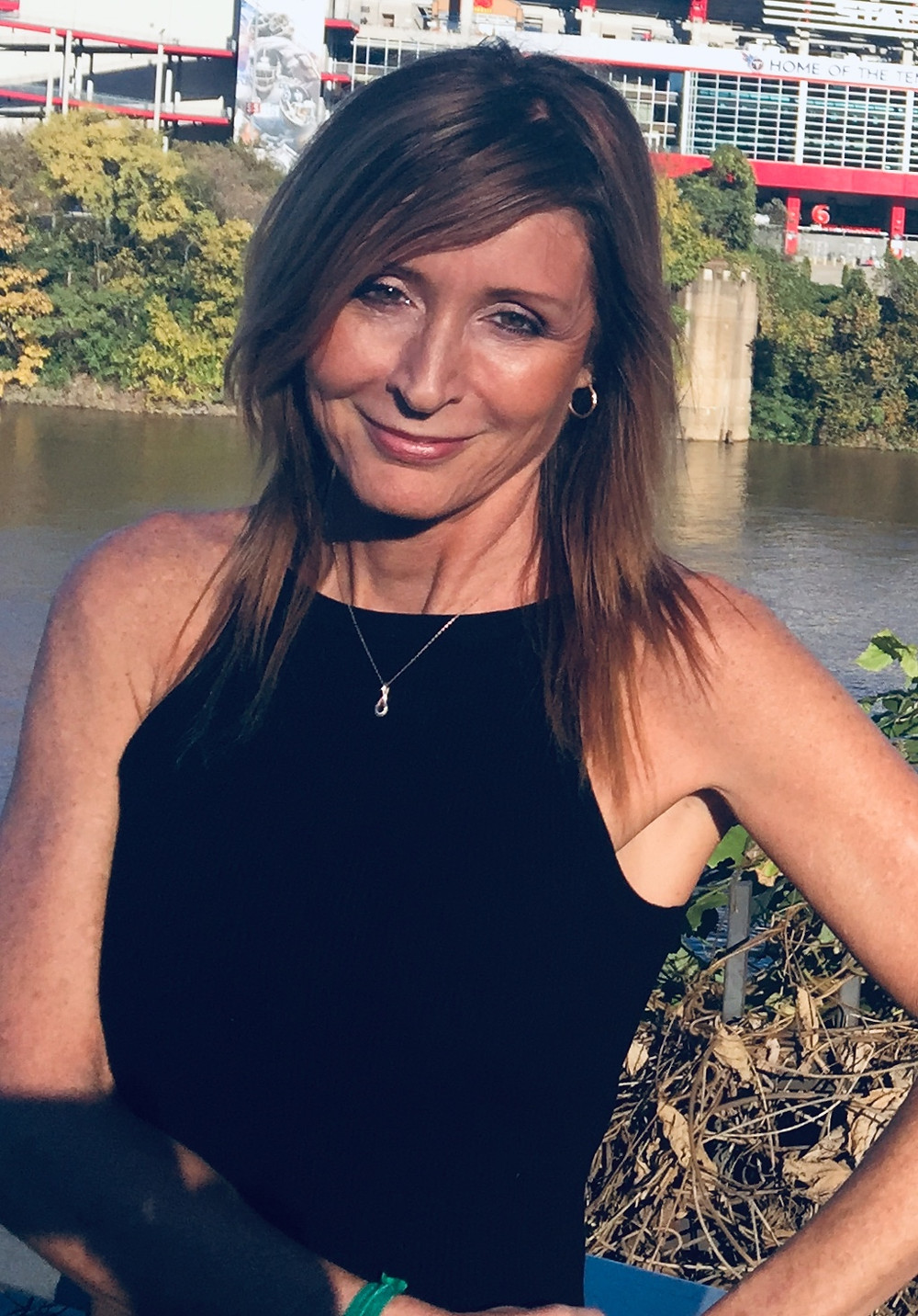 Tressa Rieser, Primal Health Coach, enjoying the sunshine and scenery on a beautiful fall day.