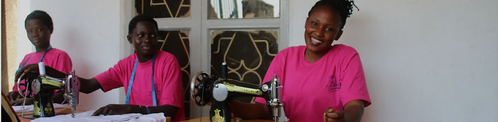 People smiling with sewing machines
