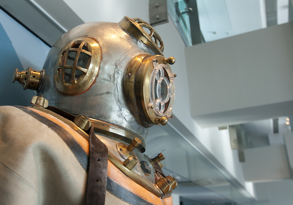 Historical dive suit with a steel and copper dive helmet